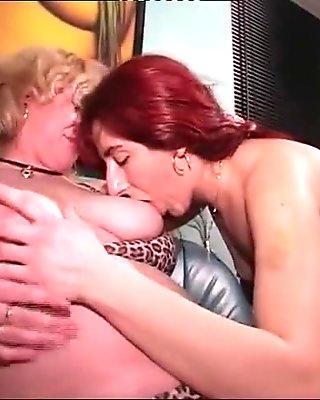 Redhead milf screws and her blonde friend joins in!