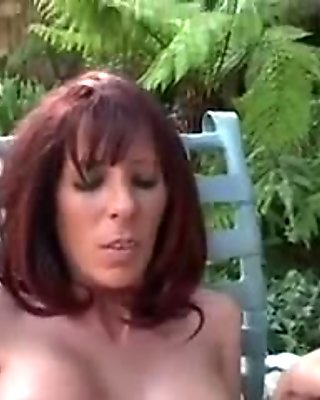Mature milf redhead fucks in the garden