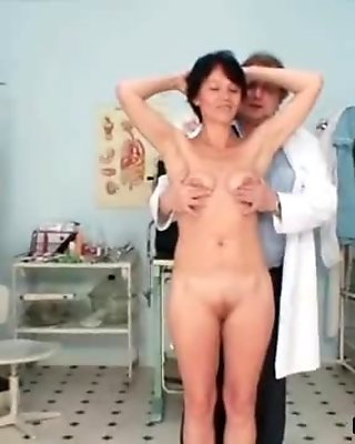 Fat mature  spreads her legs and gets
