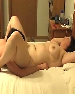 Chubby brunette wife gets her shaved cameltoe pussy eaten out and missionary fucked on the bed by her husband
