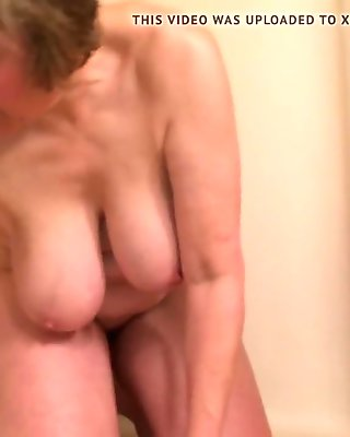 Short clip of mom's hangers while cleaning shower