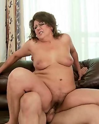 Naughty mature lady fucking a young cock