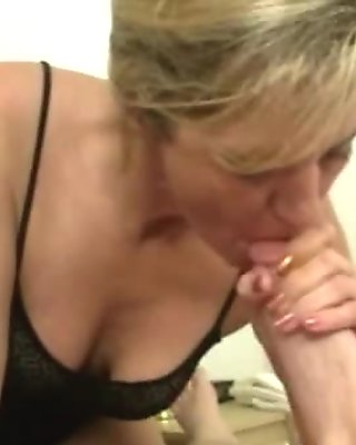 Goo loving cougar sucking a big dick