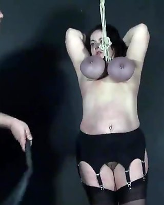 Tit hanging torture of mature roped slavegirl