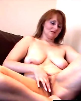 Old granny MILF working her pussy at home