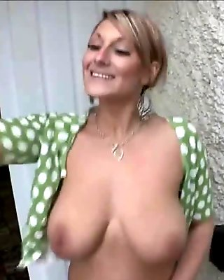 Naughty mature woman shows off her big tits on webcam