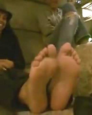 Hispanic aged shows feet outside