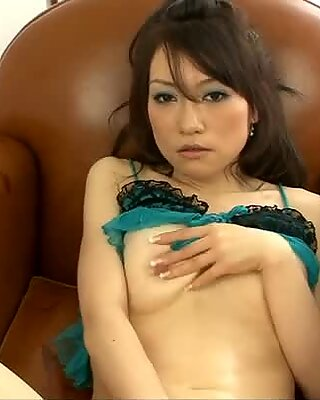 A pretty oriental girl loves to tease her pussy on camera.