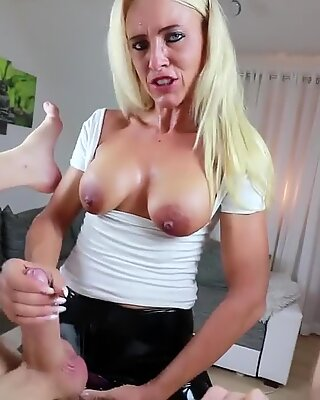 Sexy German in Latex Leggings uses her Strapon