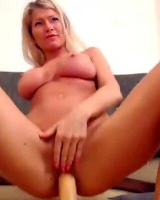 Busty amateur babe rides dildo until orgasm on webcam