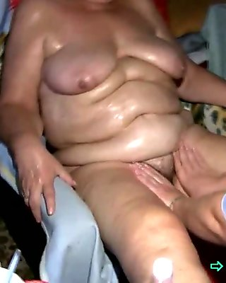 Slutty granny enjoys being oiled by young caregiver