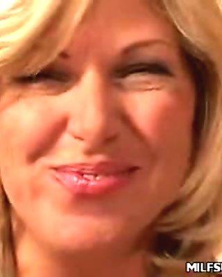 Blonde MILF Debbie Stripping