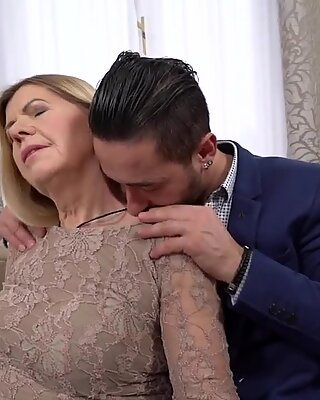 Beautiful blonde granny fucked by a stud
