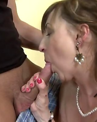 Dirty old slut wakes up young boy