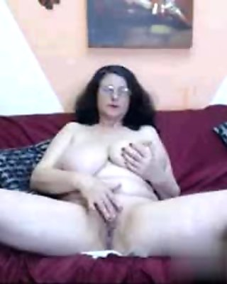 Sexy MILF rubbing her lovely tits with pleasure