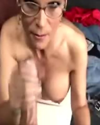 Horny milf gets facial after tuggin cock and loves it