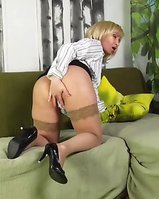 Blonde granny teases the camera before getting fucked