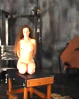 Young long-haired teen flogged in BDSM dungeon