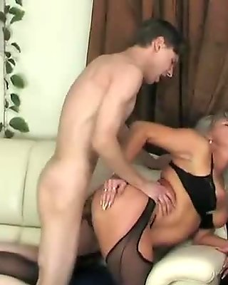 MILF surprise him jerk off and gives help
