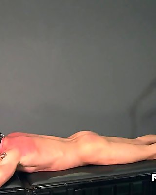 Leather clad femdom whips her mature mal slave