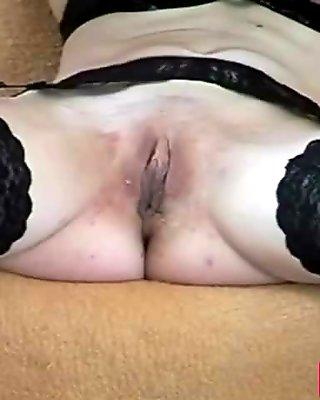 Blonde mature slut shoves dildo in shaved cunt