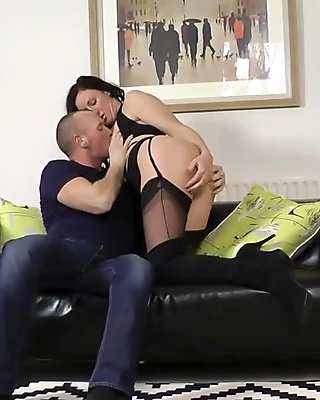 Kinky stockinged MILF takes cum in mouth