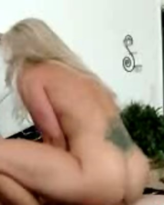 Tattooed bigtitted mature bouncing on cock