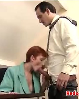 Mature Redhead In The Office