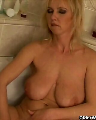 Curvy old woman with big tits dildoing in bathroom