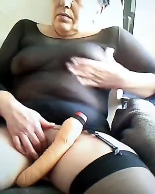 Mature lesbian and friend in stockings play with vibes